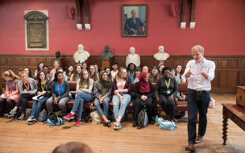 Students listening to a lecturer in the Oxford Union