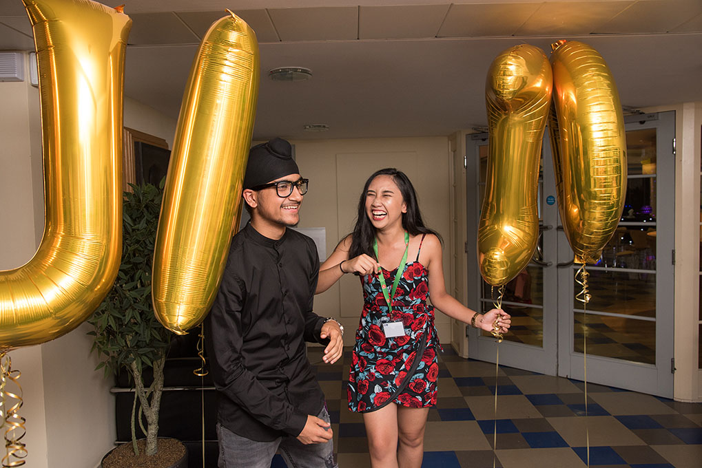 Two students with balloons