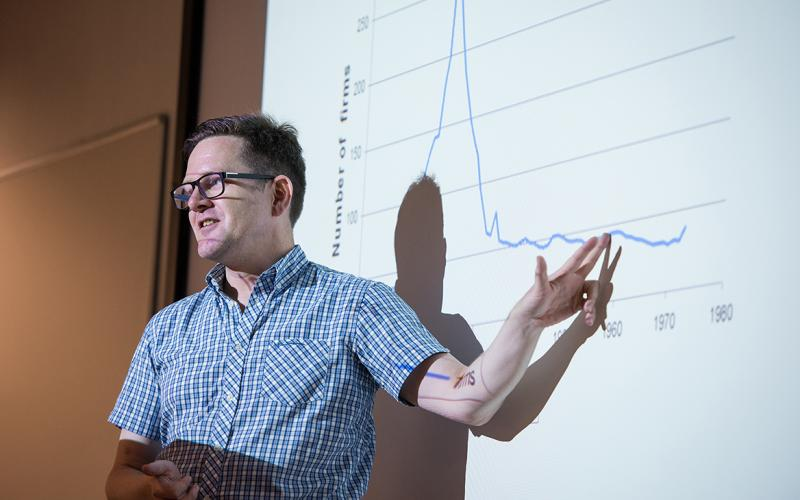 Lecturer pointing at a graph